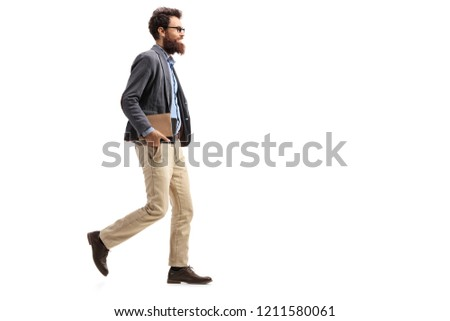 Full length shot of a man holding books and walking isolated on white background #1211580061