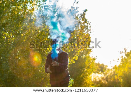 smoke bomb urban lifestyle concept running and jumping #1211658379