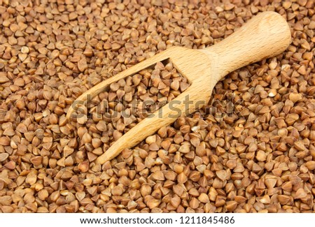 Food ingredients: buckwheat scattered with a wooden scoop #1211845486