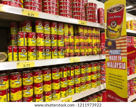 Kuala Lumpur, Malaysia - October 25 2018: Ayam Brand sardine in a can on display at a supermarket. The sardine in tomato sauce is canned in Malaysia. #1211973922