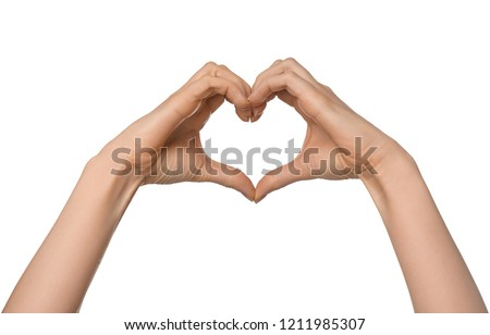 Woman making heart with her hands on white background #1211985307