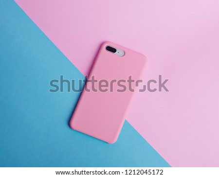 Pink phone case back view. Template of iphone 8 plus case. Blue and pink background  #1212045172