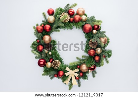 top view of decorative festive wreath with red and golden christmas toys isolated on white #1212119017
