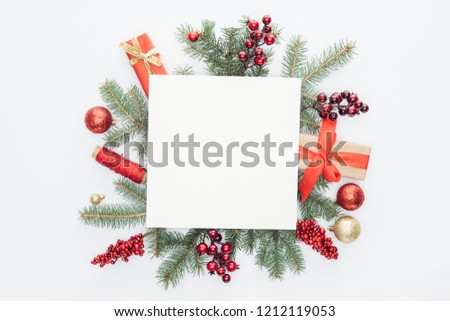 top view of pine tree branches, christmas decorations and gifts with square blank space in middle isolated on white #1212119053