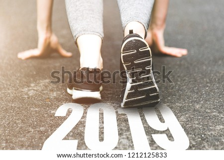 beautiful girl in sports uniform running around. Healthy way of life, an infused figure. sneakers close-up, finish 2018. Start to new year 2019, plans, goals, objectives #1212125833
