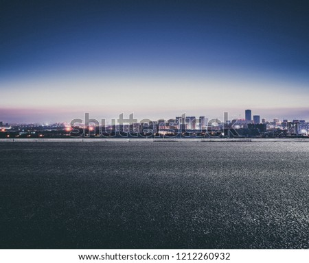 a city far away from the road after the sun sets in the evening  Royalty-Free Stock Photo #1212260932