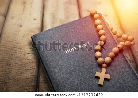 The Holy bible on a wooden table. Christianity concept. Holy Bible background. Christian background. Faith hope love concept. #1212292432