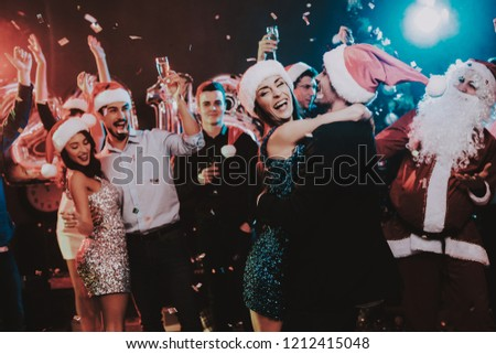 Happy Young People Dancing on New Year Party. Happy New Year. People Have Fun. Indoor Party. Celebrating of New Year. Young Woman in Dress. Young Man in Suit. Happy People. Modern Dances. #1212415048