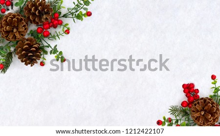 Christmas decoration. Frame of twigs christmas tree, brown natural pine cones and red berries on snow with space for text. Top view, flat lay #1212422107