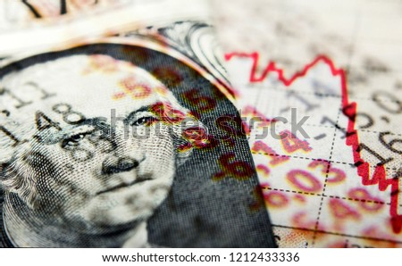 Stock Market Graph and dollar bill. Red trend line indicates the stock market recession Royalty-Free Stock Photo #1212433336