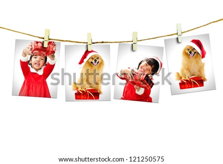Photos of little girl and dog wearing Santa Claus hat  hanging on white background.