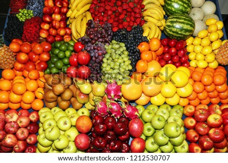 Background from freshly picked apples, pears, bananas, grapes, strawberries, cranberries, lemons, melons, raspberries, currants, blackberries, peaches, gooseberries, apricots, peaches #1212530707