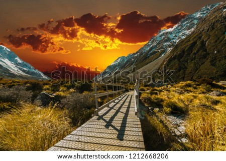 Pedestrian walkway with sunset background #1212668206