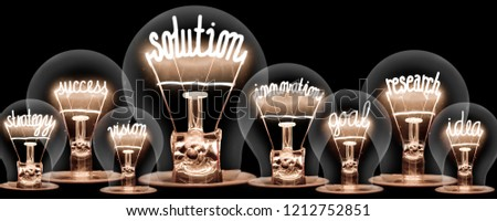 Photo of light bulbs group with shining fibers in a shape of SOLUTION concept related words isolated on black background #1212752851