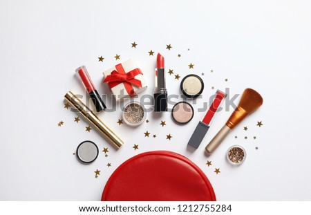 Flat lay composition with makeup products and Christmas decor on white background #1212755284