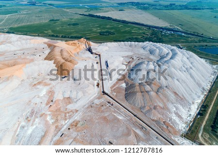 Huge mounds of unused rock. The system of long belt conveyors. #1212787816