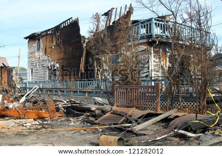BREEZY POINT, NY - NOVEMBER 20: Burned houses in the aftermath of Hurricane Sandy on November 20, 2012 in Breezy Point, NY. More than 80 houses were destroyed in out-of-control six-alarm blaze. #121282012
