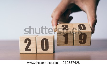 New year 2019 change to 2020 concept, hand change wooden cubes #1212857428