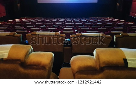 Cinema hall with filled with empty seats #1212921442