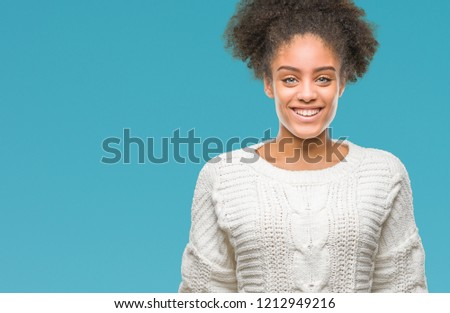 Young afro american woman wearing winter sweater over isolated background with a happy and cool smile on face. Lucky person. #1212949216