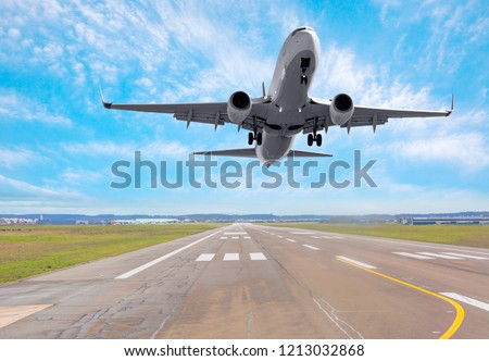 White Passenger plane fly up over take-off runway from airport  #1213032868