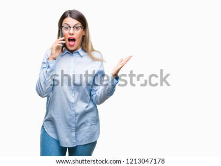 Young beautiful business woman speaking calling using smartphone over isolated background very happy and excited, winner expression celebrating victory screaming with big smile and raised hands #1213047178
