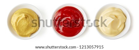 Bowls of ketchup mayonnaise and mustard isolated on white background, top view #1213057915