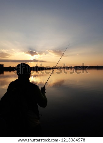 fishing in the sunset. #1213064578