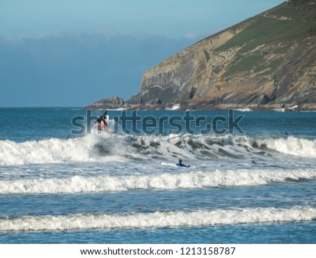 Surfers at Croyde Bay, North Devon Royalty-Free Stock Photo #1213158787