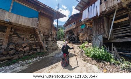 Artvin, Turkey - July 2018: Unidentified woman in local outfit walking in Maden Village , Savsat, Artvin, Turkey #1213263547