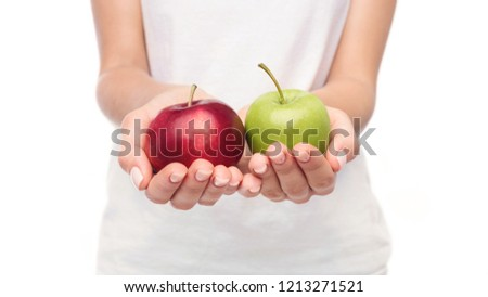 Woman offering green and red apples in her hands over white background #1213271521