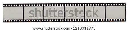 long film strip, blank photo frames, free space for your pictures to make them look retro, real high-res 35mm film strip scan with signs of usage on white background #1213311973