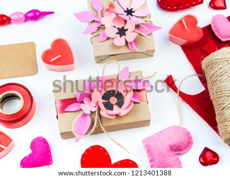 Gift wrapping for Valentine's day. Tools and decor for the holiday. Flower paper hack. Romantic setting. A gift with love. #1213401388