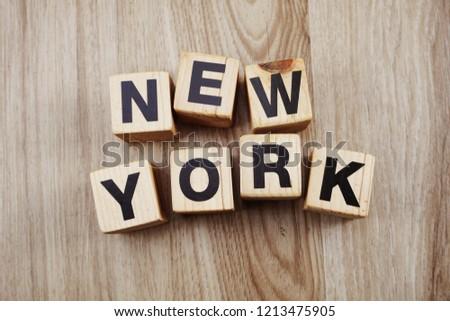 new york alphabet blocks letters on wood background