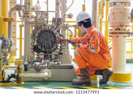 Mechanic inspector engineer check condition of crude oil centrifugal pump and lube oil system at offshore gas central processing platform, power and energy service business industry. Royalty-Free Stock Photo #1213477993