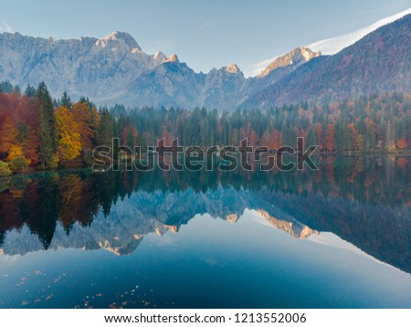Panoramic view at sunrise over alpine lake in Italy. #1213552006