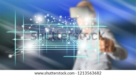 Man with vr headset touching a virtual technology concept on a touch screen with his finger #1213563682