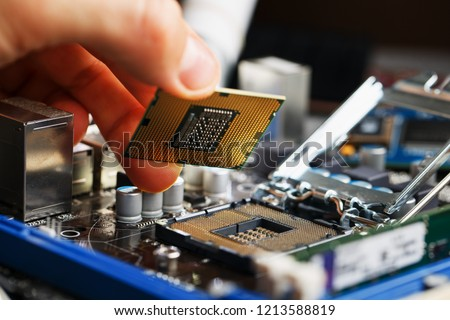 Electronic engineer of computer technology. Maintenance computer cpu hardware upgrade of motherboard component. Pc repair, technician and industry support concept. #1213588819