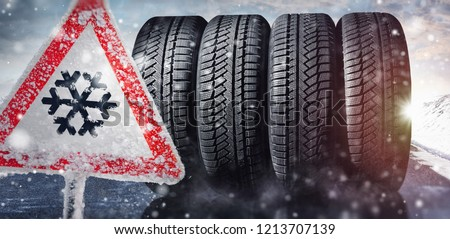 change a car tires from summer for winter - danger sign #1213707139