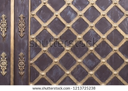Element forged gates. Part of the vintage wrought iron gate. Background, texture of metal gates. #1213725238