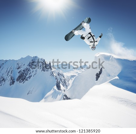 Snowboard Jumping in high mountains #121385920