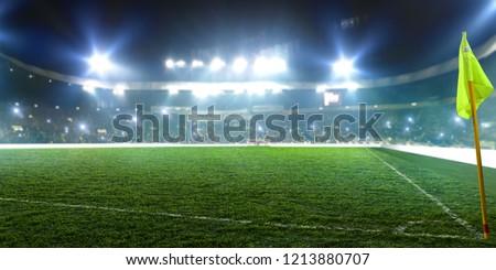 Football stadium, corner flag, shiny lights #1213880707