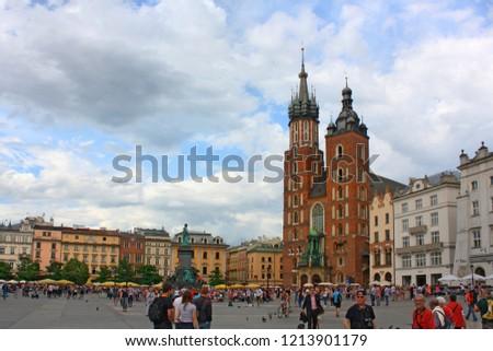 KRAKOW, POLAND - June 15, 2016: Church of St. Mary on the main Market Square (Rynek Glowny) in Krakow #1213901179