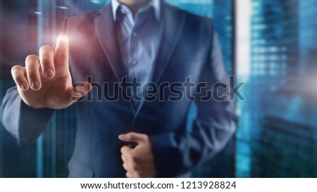 Businessman with dark suit is pointing with his finger. City background #1213928824