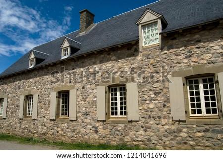 Historic buildings at the fort of Louisburg, Nova Scotia. #1214041696