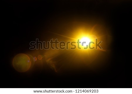 Abstract Natural Sun flare on the black background. #1214069203