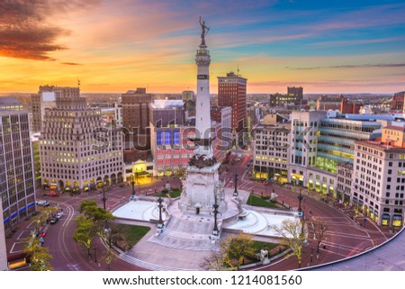 Indianapolis, Indiana, USA downtown cityscape and Monument Circle at dawn.