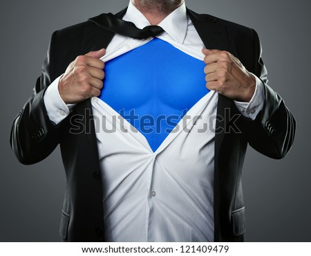 Young businessman acting like a super hero and tearing his shirt off with copy space Royalty-Free Stock Photo #121409479