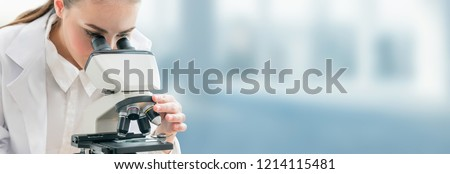 Scientist researcher using microscope in laboratory. Medical healthcare technology and pharmaceutical research and development concept. #1214115481