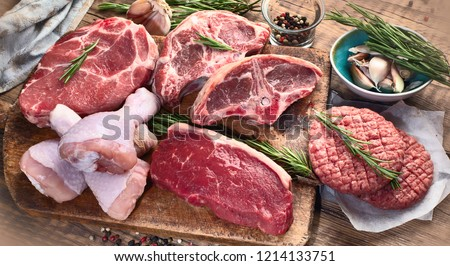 Different types of raw meat - beef, pork, lamb, chicken on a wooden board. #1214133751